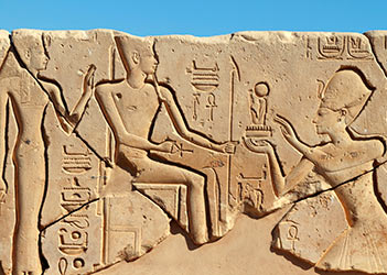 Seti I offering to Amun and Mut