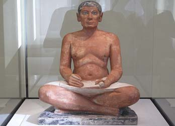 Scribe statuette displayed at the Louvre museum