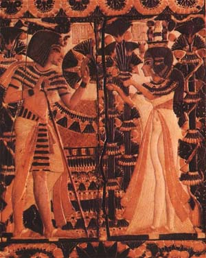 King Tut receving flowers from Ankhesenamun as a sign of love